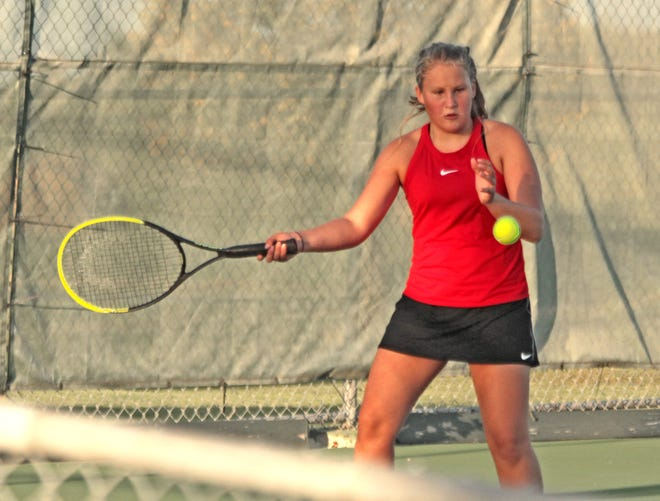 Freshman Rylee Washburn of the 2020 Chillicothe (Mo.) HS tennis Lady Hornets makes the forehand shot that closed out her 6-4 win in the first set of Tuesday's (Oct. 6) Class 1 District 15 team tournament finals No. 5 singles. Washburn then won game two 6-3 as CHS rallied during singles play to edge Trenton 5-4 and repeat as district team champs.