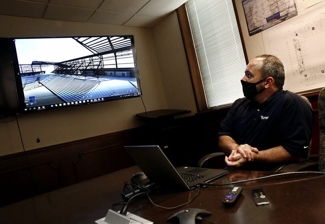 Virtual design and construction engineer Kevin Wanner looks at a 3D modeling view of the construction of the Crew stadium Downtown. [Fred Squillante/Dispatch]