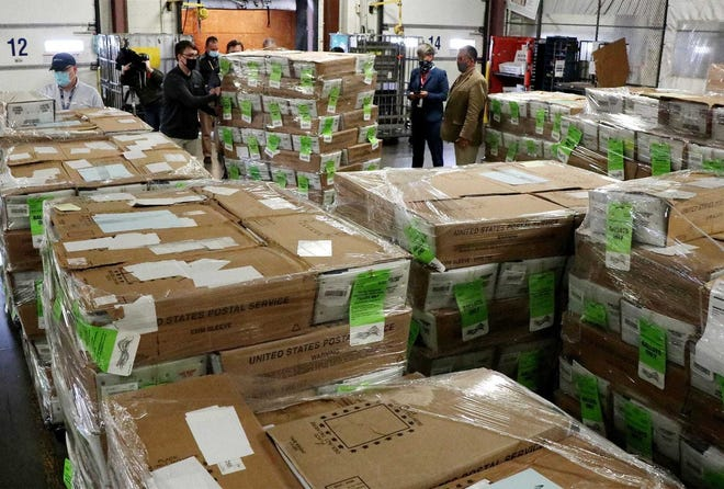 Boxes containing more than 237,000 absentee ballots are delivered Monday by workers with the Franklin County Board of Elections to the U.S. Postal Business Mail Center at 2323 Citygate Drive in Columbus.