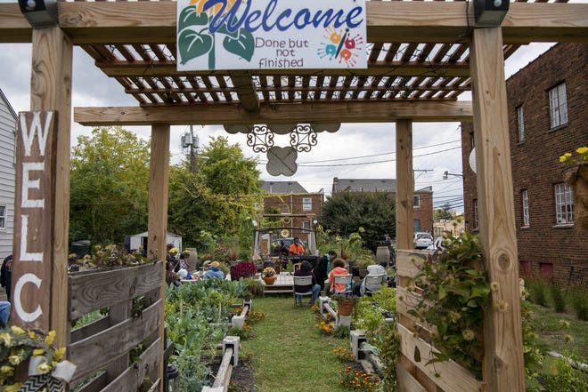Friends, family, neighbors and residents attend the end-of-summer cookout and party at the Driving Park community garden created by Marjorie Chapman in Columbus, Ohio, on Oct. 3, 2020.