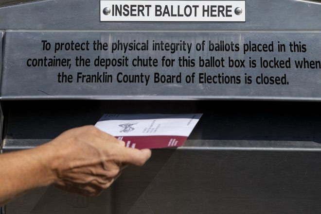 Scott DiMauro of Columbus, Ohio, drops off his ballot at the Franklin County Board of Elections in Columbus, Ohio, on Oct. 07, 2020.