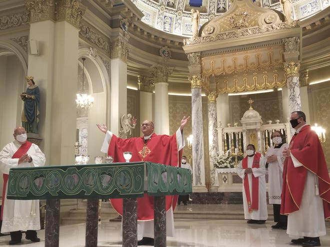 Houma-Thibodaux Catholic Bishop Shelton Fabre prays during Wednesday's Red Mass for judges and others in the local justice system at St. Joseph Co-Cathedral in Thibodaux.