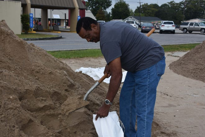 Sterling Gibson fills sandbags Wednesday in the Cannata's supermarket parking lot along West Park Avenue in Houma in preparation for Hurricane Delta.
