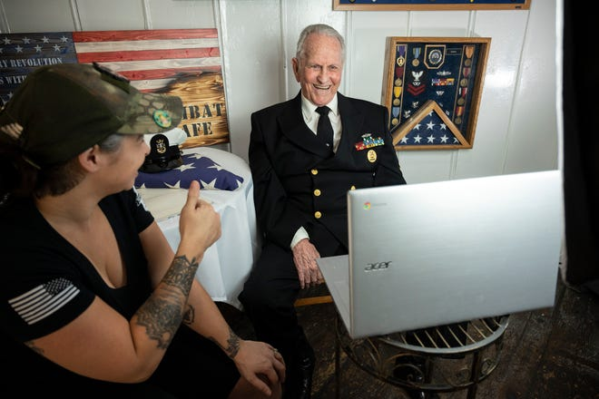 "Combat Cafe owner Beth Chambers gives Navy veteran John McCrary, ""Papa John,"" a thumbs up as he records a segment with The Kelly Clarkson Show. [Cindy Peterson/Correspondent]"