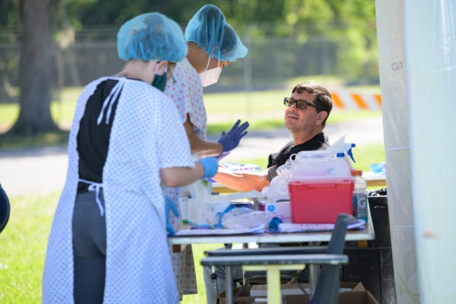 A man gets tested for the COVID-19 antibody earlier this year at Venetian Gardens in Leesburg. [Cindy Sharp/Correspondent]