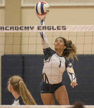 First Academy of Leesburg senior Kali Walker (1) spikes the ball during a match Tuesday against Ocoee Central Florida Christian Academy at the Family Life Center in Leesburg. [PAUL RYAN / CORRESPONDENT]