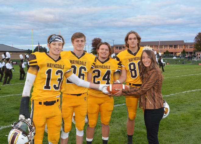 2020 Waynedale High School Homecoming Queen Summer Miller presents the game ball to senior football players Gabe Mathias, Storm Stanley, Kane Murray and Jerren Cutshaver before the Waynedale Homecoming game Friday, Oct. 2. Waynedale won the game 28-27 over Chippewa.