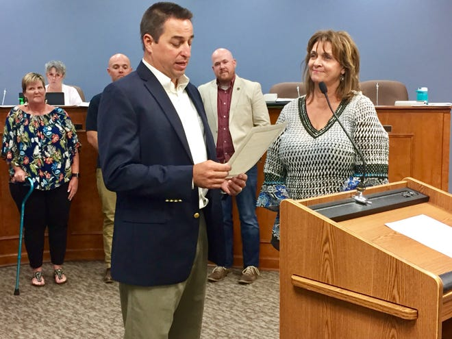 Former Spring Hill Vice Mayor Bruce Hull reads a proclamation to Alderman Hazel Nieves in 2017 for her contributions as founder and organizer of the annual Pay It Forward Festival. (Staff photo by Jay Powell)
