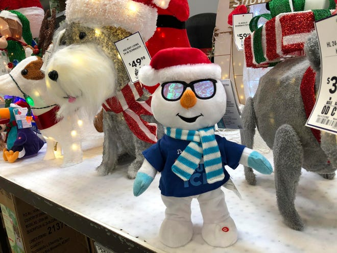 Holiday knickknacks are displayed for Christmas shoppers on Oct. 2 at a Lowe's store in Northglenn, Colo. Add last-minute holiday shopping to the list of time-honored traditions being upended by the coronavirus pandemic.