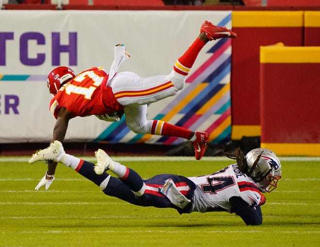 New England Patriots cornerback Stephon Gilmore, bottom, tackles Kansas City Chiefs wide receiver Mecole Hardman in Sunday's game at Arrowhead Stadium. The Patriots canceled practice Wednesday after Gilmore reportedly tested positive for the COVID-19 virus.