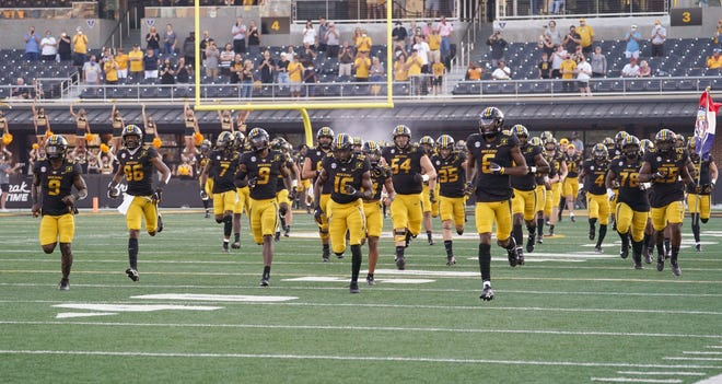 Missouri football players take Faurot Field prior to the season opener against Alabama. The Tigers weren't scheduled to return home until Oct. 17 but the Southeastern Conference is expected to announce Wednesday morning that it is moving Saturday's scheduled game at LSU to Columbia because of the impending effects of Hurricane Delta.