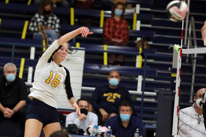 Notre Dame High School's Kathryn Stephens (16) puts the ball over the net during their match against Van Buren High School, Tuesday Oct. 6, 2020 at Notre Dame's Father Minett gymnasium.