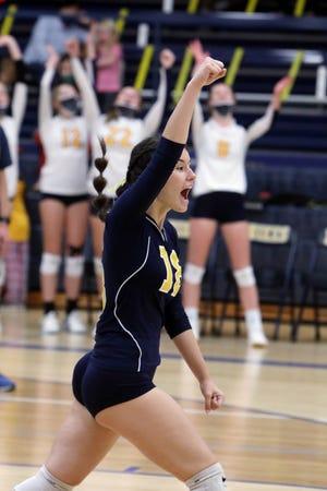 Notre Dame High School's Molly Johnson (18) celebrates a point during their match against Van Buren High School Tuesday, Oct. 6, at Notre Dame's Father Minett gymnasium.