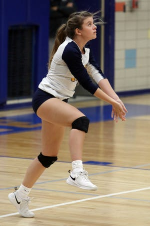 Notre Dame High School's Kerrigan Belger (10) waits to returns the ball during their match against Van Buren High School Tuesday, Oct. 6, at Notre Dame's Father Minett gymnasium.