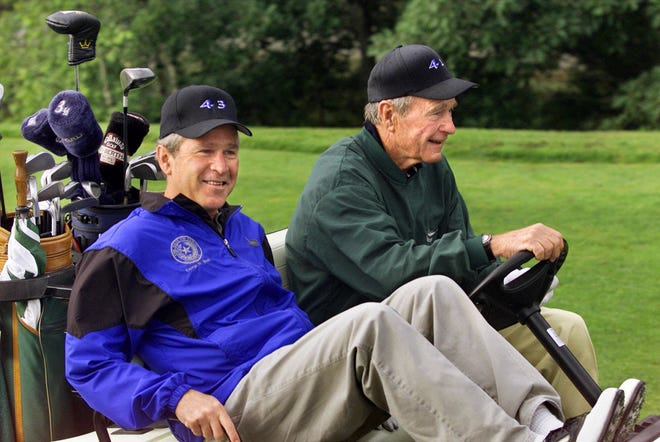 "Former Presidents George W. Bush (left) and his father, George H.W. Bush, are the first father-son team to be honored with the Bridgestone Senior Players ""Ambassador of Golf Award."""