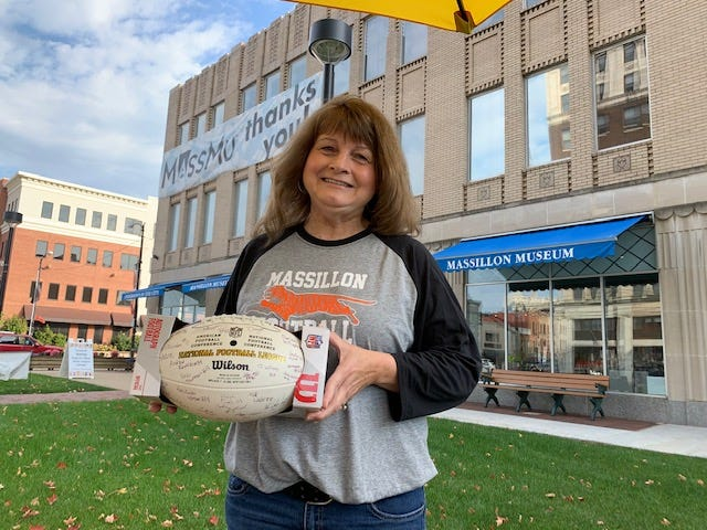 Patty Emmert, a lifelong Tigers fan, was the winner of the Downtown Massillon Association's football giveaway. The pigskin featured the autographs of the 2020 Tiger football team.