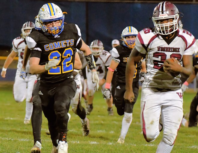 Woodridge running back Dayshawn Garr breaks away from the Coventry defense during the Bulldogs' 35-28 win at Coventry Oct. 2. Garr ran for 199 yards and two touchdowns in the win.