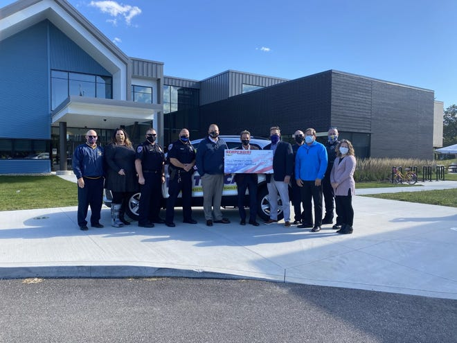 Tallmadge Elementary and Tallmadge Middle schools received a donation of $7,500 from Serpentini Chevrolet and Tallmadge Serpenti. Pictured from left are Mark Fairhurst, Meghan Thompson, Police Chief Ron Williams, Officer Dornack, Nathan Gault, Bob Serpentini, Jeff Ferguson, Fire Chief Michael Passarelli, Mayor Dave Kline, SRO Dave Quillen and Molly Gilbride.