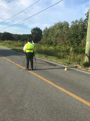 Polk County Sheriff's Office deputies work the scene of a fatal crash on Kathleen Road Wednesday.