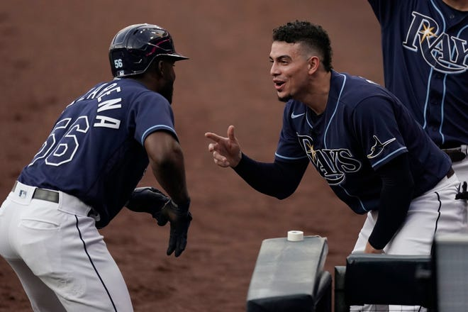 Tampa Bay's Willy Adames, right, greets Randy Arozarena after Arozarena hit a solo home run in Game 2 Tuesday in San Diego.