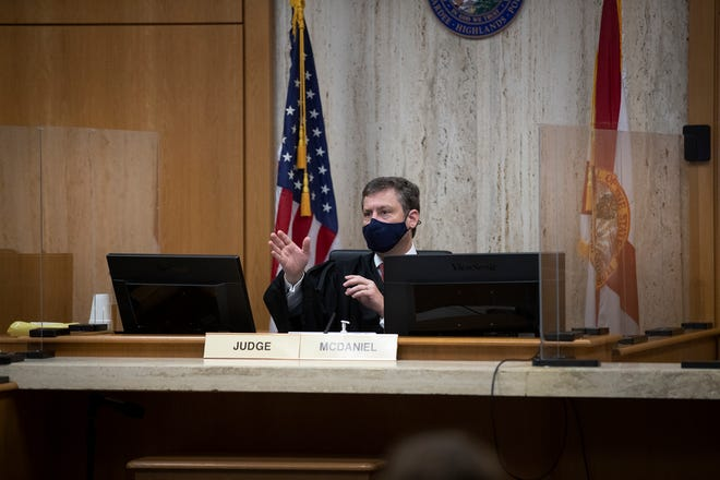 Circuit Judge Michael McDaniel wears a mask and has a plexiglass barrier around him during jury selection in the Frankie Jackson trial in Bartow on Wednesday. The trial was the first held in the Polk County Courthouse since March.