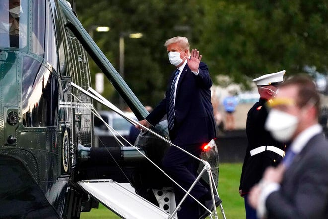 In this Oct. 5, 2020, file photo, President Donald Trump boards Marine One at Walter Reed National Military Medical Center after receiving treatment for coronavirus in Bethesda, Md. Ethics experts say the special treatment Trump received to access an experimental COVID-19 drug raises fairness issues and the public's right to know more about Trump's condition.