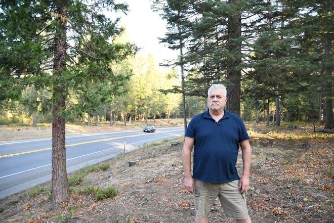 Retired CAL FIRE Captain and McCloud resident Steve Richardson stands where the forest has been cleared along Highway 89 as a fuel break to protect his town from wildfires. Collaborating with state and federal agencies, Richardson, who is part of the McCloud Fire Safe Council, is planning to continuing this fuel break from McCloud to Mount Shasta.