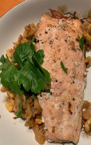 Cauliflower rice served with salmon.
