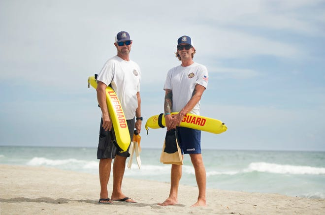 Town of Palm Beach chief lifeguard Craig Pollock (left) and lifeguard Lex May rescued two swimmers after they were caught in a rip current at Midtown Beach on Monday.