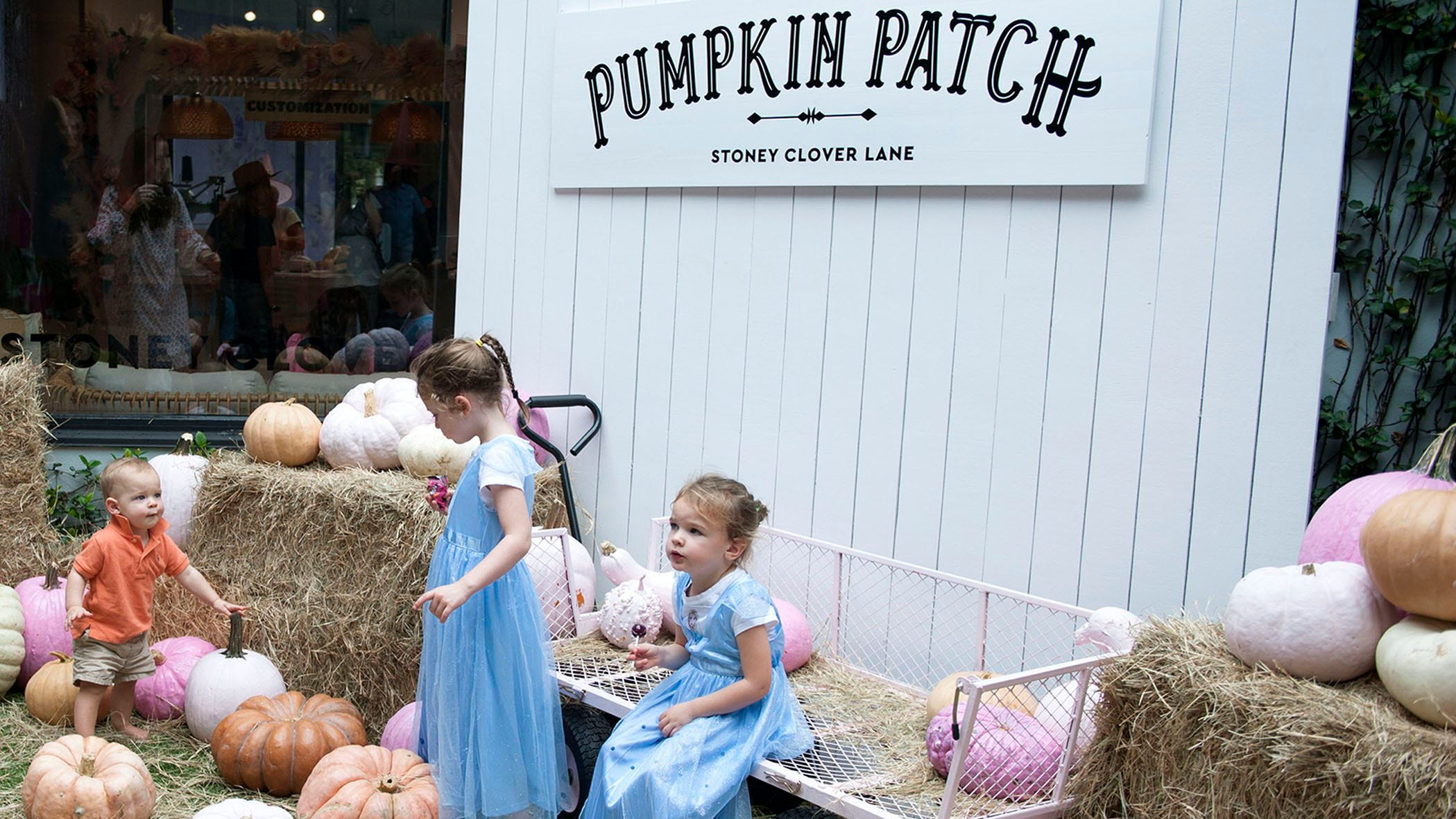 From left, Jack, Arabella and Adriana Lux play in pumpkin patch during The Royal Poinciana Plaza's Pop-Up Patch in 2019.