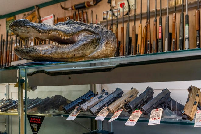 Firearms are on display at Gator Guns & Pawn in West Palm Beach on Oct. 7.