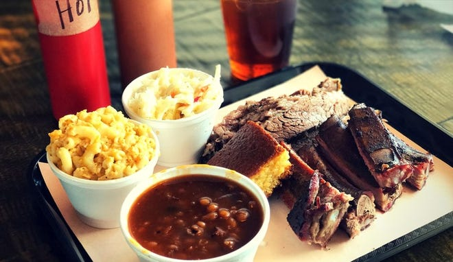Top seller: The ribs and brisket combo at Troy's Barbeque, served here with mac and cheese and baked beans, is a customer favorite. [Laura Lordi, The Palm Beach Post]