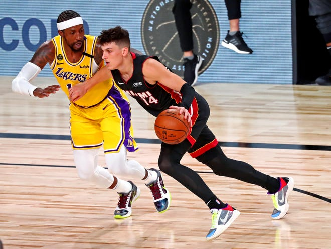 Heat guard Tyler Herro (14) drives to the basket against Los Angeles Lakers guard Kentavious Caldwell-Pope (1) during Game 4 of the 2020 NBA Finals at AdventHealth Arena. [Kim Klement-USA TODAY Sports]