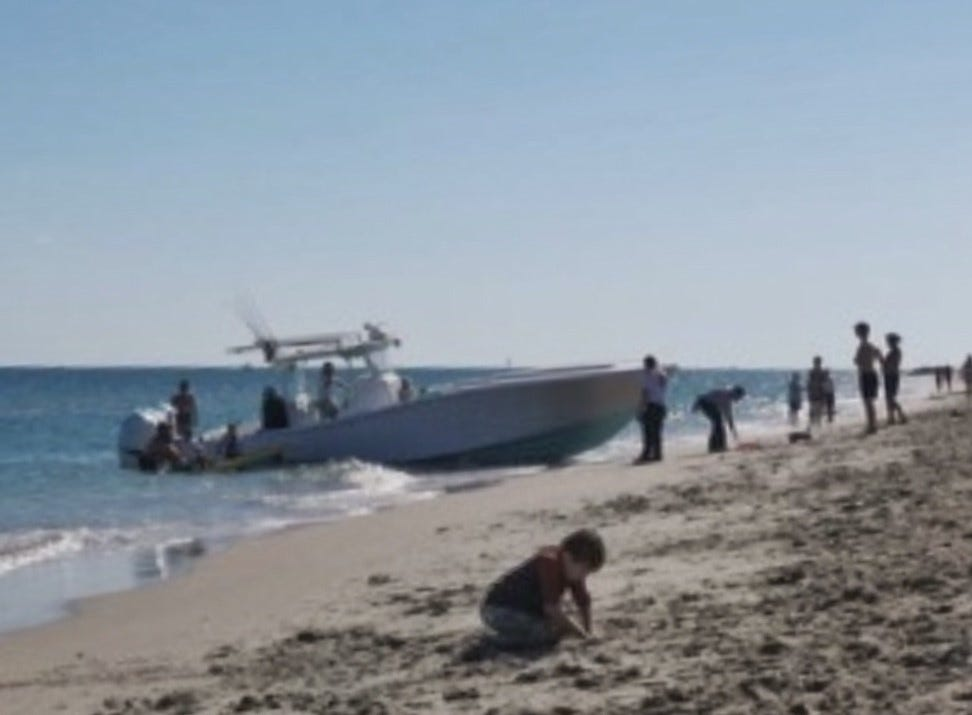 In this image taken by a beachgoer, Carter Viss is pulled from the boat onto a stretcher after the ocean accident on Thanksgiving Day 2019.