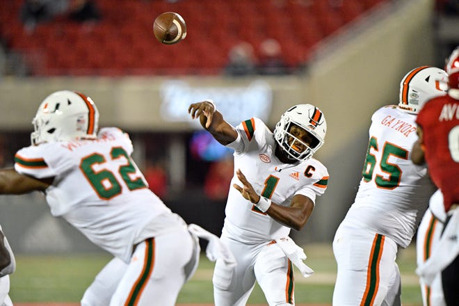 Miami quarterback D'Eriq King, throwing against Louisville during the Hurricanes' 47-34 victory last month, drew praise from Clemson coach Dabo Swinney.