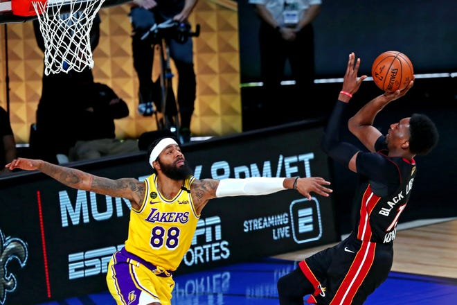 Heat forward Bam Adebayo (13) shoots against Lakers forward Markieff Morris (88) during the second quarter of Game 4 of the NBA Finals Tuesday night.