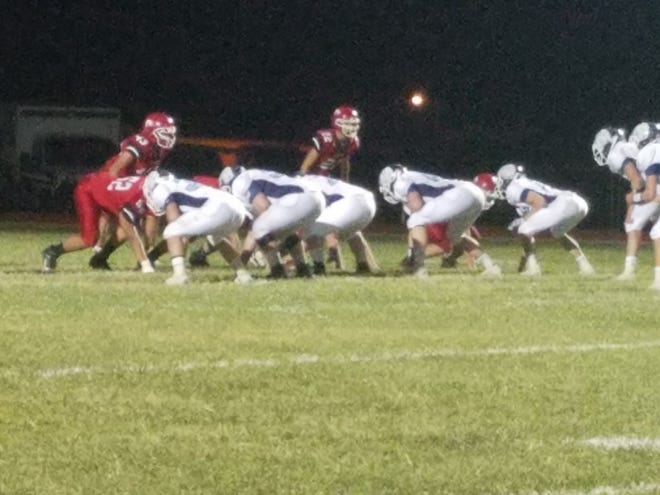 Skyline High School defensive lines up to stop the Kinsley Coyotes in a high-soring Friday night game last week, won by the Thunderbirds 90-56. And Skyline looks to keep an undefeated streak alive this week.