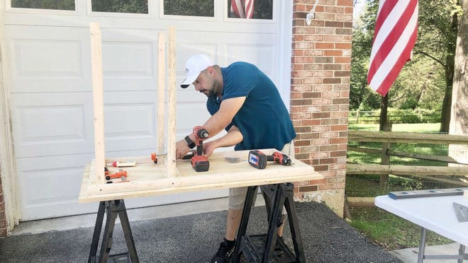 Al Berrellez, co-founder of Desks By Dads, a charity in Gaithersburg, Md. The Temple Israel Men's Study Group in Canton is making 30 Desks By Dads for students at Lehman Middle School.