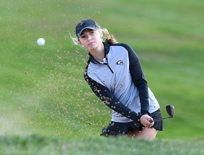 Green's Emily Liptak hits out of the trap on the second hole during Wednesday's Division I sectional tournament at Elms Country Club.