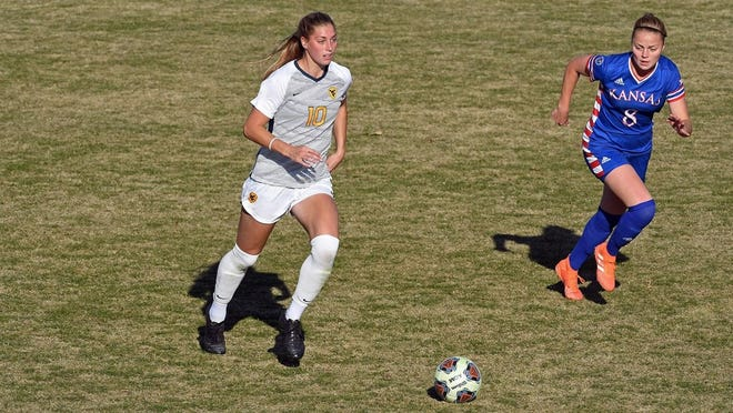 Hoover High School graduate Jordan Brewster scored a goal and anchored a solid defense in seventh-ranked West Virginia's 2-1 win over Texas.