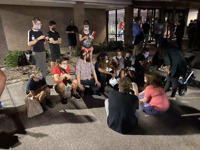 A group of supporters for the Black Lives Matter movement sit outside the Sarasota County School Board building during Tuesday's meeting.