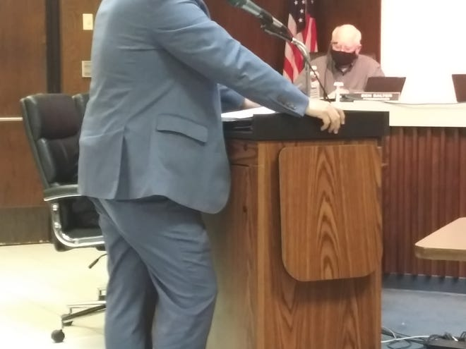 During the citizen participation segment of Shawnee City Commission's meeting this week, developer Mike Little shares information about a $10 million project downtown.
