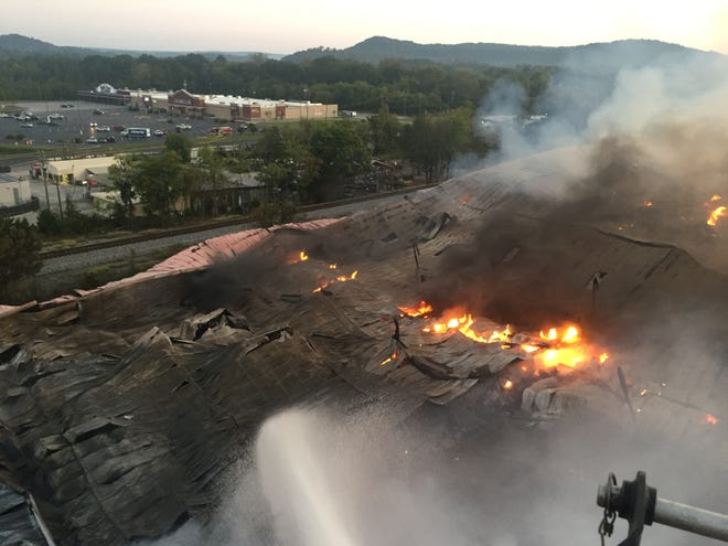 Tim Ramsey of the Gadsden Fire Department took this photo of the Gadsden Warehousing fire from a GFD ladder truck, showing the crumpling roof of the building as the fire burned beneath it.