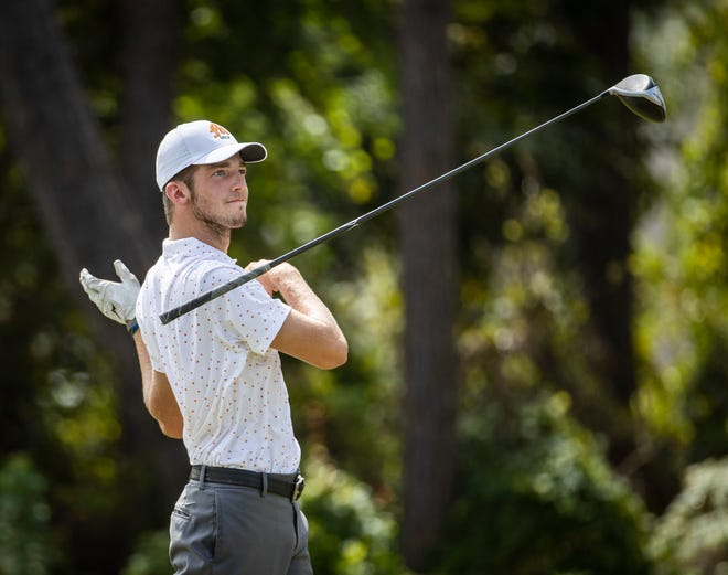 Mosley golfer Morgan Hughes loses his driver after teeing off on the second hole. The Bay County boys high school golf tourney was held at Holiday Golf Club Tuesday, October 6, 2020. [MIKE FENDER / FOR THE NEWS HERALD]