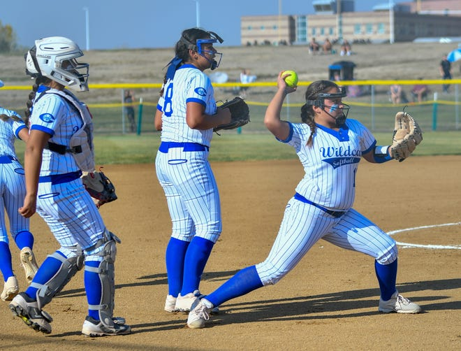 Pueblo Central's Surenity Ramos, right, throws to first for an out while Savannah Autobee, middle, and Jade Mares watch against Silver Creek in the first round of the Class 4A state playoffs Tuesday, Oct. 6, 2020, at Silver Creek High School.