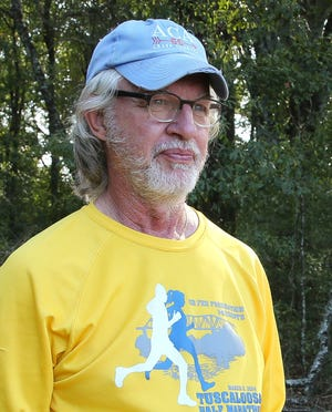 Charles Tiller, cross country coach for American Christian Academy, oversees practice in Sokol Park Tuesday, Oct. 7 2020. [Staff Photo/Gary Cosby Jr.]