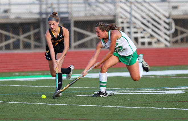 Emily Barker (left) and the Upper Arlington field hockey team are preparing for the district tournament. The Golden Bears outscored their opponents 47-19 through 14 games.