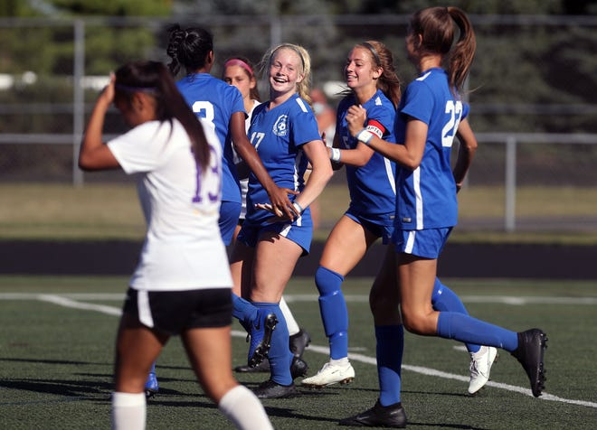 Liberty's Jaimason Brooker (17) celebrates with teammates after scoring against DeSales on Sept. 5. Brooker has been helping the Patriots enjoy a bounce-back season, scoring a team-high 18 goals through 12 games.