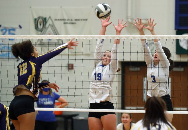 Central Crossing's Amy Thompson (19) and Casey Brooks (3) attempt to block a hit from Reynoldsburg's Carmen Heckman during a match Sept. 22. The Comets are looking to show improvement before competing in the Division I district tournament.