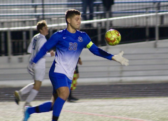 "Davidson senior goalie Lorenzo Nieves clears the ball during a 2-0 loss at Olentangy Liberty on Oct. 6. Nieves is a four-year starter in goal. ""He's an exceptional athlete as far as his technical skills and communication in the back,"" coach Dan Hoover said."